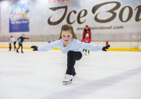 Girl preforming iceskating move